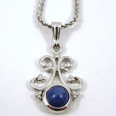 Round Star Sapphire Pendant. Set in Sterling Silver.-$500