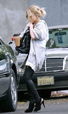Mary-Kate Olsen out and about with a cute messy ponytail, oversized zip-up hoodie and leather leggings. #style #fashion #olsentwins #leatherpants #hairinspiration