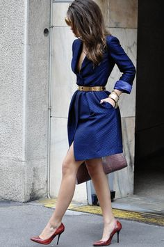 Maritsa in an electric blue Emperio Armani trench accessorized w/ a gold belt, red shoes & Emperio Armani bag #StreetStyle