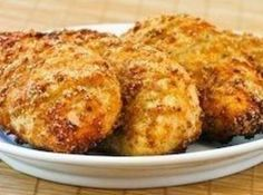 MELT IN YOUR MOUTH CHICKEN Recipe:  1/2 c. parmesan cheese  1 c. greek yogurt - plain 1 tsp garlic powder  1 1/2 tsp seasoning salt  1/2 tsp pepper  Spread mix over chicken breasts, bake at 375 for 45 mins.