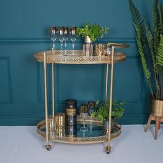 Cocktail hour: best bar carts and drinks trolleys Gorgeously glam antique gold mid-century inspired bar cart drinks trolley. Great for storing glasses and cocktail accessories on, as well as to use for serving drinks at parties. Bar Trolley, Drinks Trolley, Bar Carts, Hostess Trolley, Serving Trolley, Metal Bar Cart, Gold Bar Cart, Party Drinks, Fun Drinks