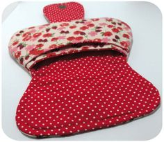 This cute pouch has two pockets--the main pouch pocket and a second pocket built into the front. The front pocket extends across the width of the clutch and is sewn closed just a bit along the top of each side to give it some security.