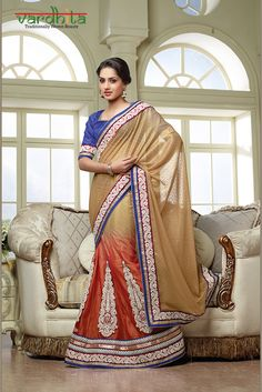 Beige & orange color lehanga saree on chiffon butti & net fabric, this saree has resham thread zari lace border work with two side pipping with patch work. It's a wedding function or party wear saree with purple color dhupion blouse which can be stitched up to size 44.