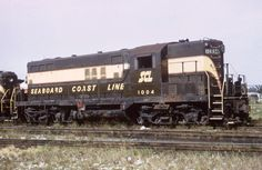 A Seaboard Coast Line Railroad diesel engine. SCL was created July 1, 1967, as a result of the merger of the Seaboard Air Line Railroad (SAL) with the Atlantic Coast Line (ACL).  In 1982, the SCL became Seaboard System Railroad when merged with the Louisville and Nashville Railroad (L&N). Prior, the SCL and the L&N had been under common ownership of a holding company, Seaboard Coast Line Industries (SCI), the company's subsidiaries being known as the Family Lines System. In 1986 CSX was…