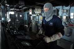 Sailor drives the ship during a drill. by Official U.S. Navy Imagery, via Flickr