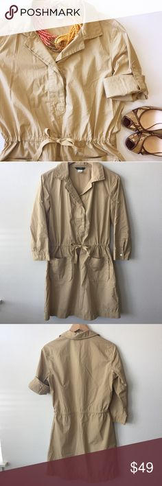 """J.Crew Tan Khaki Utility Shirt Dress w/ Drawstring J.Crew Khaki Utility Shirt Dress Size: Small. Retail: $148 Tan khaki color. Hidden button placard on chest. 3/4 sleeves with button-tab to secure sleeves when rolled up. V-Neck. Adjustable drawstring waist. Two real patch pockets on front hips. Pullover style.  A-line skirt. Lightweight; 100% Cotton. Bust: 38"""" Waist: 35"""" (adjustable drawstring) Hips: 42"""" Length: 34.5"""" 💎Excellent pre-loved condition! No flaws. You may just mistake this for…"""