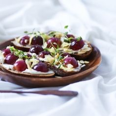 Goat cheese almonds and roasted grapes bruschette. Love the flavor combination.   www.riley-jane.com