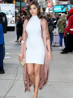 Beauty queen: Olivia Culpo shined in a bright white dress Tuesday while strolling in New York City