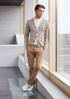 Khaki Chinos styled with Grey Cardigan , White Tshirt and White Low Top Sneakers
