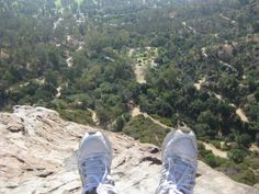 My feet at the infamous Bee's Nest in Griffith Park. Scary scary cliff!