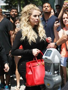 Big hair, don't care: Khloe Kardashian was in the mood so switch up her style on Tuesday a...