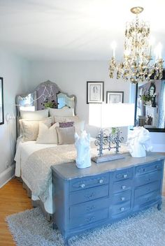 I like the idea of putting the dresser at the end of the bed.  Add a lamp and you have a nice pairing with the chandelier.  Brilliant!