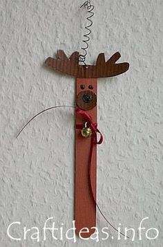 Christmas Crafts for Kids - Craft Stick Reindeer = Craft Stick, brown paper + thin red ribbon + tiny bell + 3 dimensional black craft paint. (Use craft foam instead of brown paper to make it a waterproof swap) Christmas Craft Projects, Christmas Activities, Holiday Crafts, Christmas Holidays, Christmas Decorations, Christmas Ornaments, Craft Decorations, Christmas Books, Spring Crafts