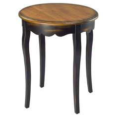 Round end table with a scalloped apron.  Product: End tableConstruction Material: WoodColor: Bro...