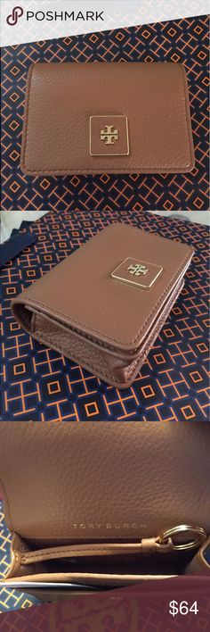 """🆕Tory Burch """"Clara"""" Key/Card Leather case. NWT Practical envelope style key/card case can hold your keys safely so they won't scratch up your handbag. 2 card slots… 1 on the front under flap and 1 on the back. Inside there's plenty of room to attach your keys to the key ring. Pretty luggage color (Bark) is the perfect size in durable leather. Great to give as a gift. Approximate Measurements: 4-1/4"""" L x 3.0"""" H x 1.0"""" D. Tory Burch Accessories Key & Card Holders"""