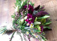 Wild look bridal handtied bouquet if sweet william, veronica, daisies, solidago, lisianthus and rosemary. www.enchantedflorals.co.uk