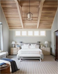 transom windows and vaulted wood ceiling