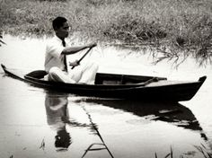 Young King Bhumipol Adulyadej (Rama IX) the great of Thailand paddle.