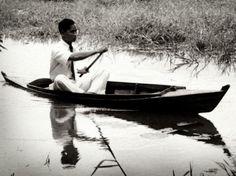 Young King Bhumipol Adulyadej (Rama IX) the great of Thailand paddle.