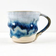 Swirly mug in Storm Blue. This was the first test mug so that handle isn't quite right but I'm happy with how it's looking. The next lot will be bisqued today then I need to pick glazes for them. #pottery #clay #instapottery #claystagram #potterylove #potterylife #pottersofinstagram #kilnfolk #ceramic #ceramics #contemporaryceramics #handmade #handmadepottery #createmakeshare #glaze #cone6 #wheelthrown #mugshot