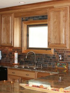 Oak cabinet granite countertop with rustic slate mosaic kitchen backsplash from Backsplash.com