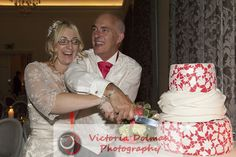 Fun Cake Cutting Amalfi White Wedding Photograph