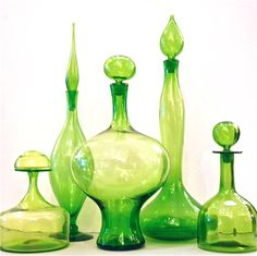 A refreshing collection in a zesty lime green coloration. All by Blenko, with the exception of the squat decanter at the very left, which is by another great American glass factory called Greenwich Flint Craft.