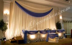 Toronto Wedding Decorations - Custom Traditional Simple Backdrop and Head Table Draping Design by Mapleleaf Decorations in Corn Blue and ivory sheer fabrics. Contact us for more info www.MapleleafDecorations.com