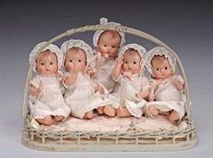 tiny set of Madame Alexander Dionne Quintuplet baby dolls