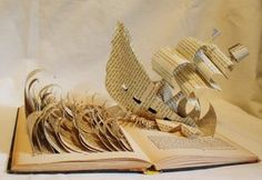 """Pirate Ship Book Alteration by *wetcanvas on deviantART: A pirate ship is fighting the stormy seas and exploding out of the pages! """"Kidnapped"""" by Robert Louise Stevenson was first published in 1886. This altered volume is later, c. 1950s. The rough waves are sculpted from the books pages, while the ship (constructed from another book due to the fragility of the """"Kidnapped"""" book's pages) cuts through the pages, making waves of it's own."""