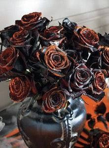 Turn your buffet table into a serving space to die for with Grandin Road's Halloween Table Decor ideas, like black roses, a bubbling cauldron and more.