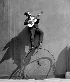 ♂ Black & white photography man on bike play guitar Photo by Ken Russell, 1956