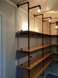 Check out this list of wall mounted DIY pantry shelving ideas to inspire your next project. These were built using pipe and Kee Klamp fittings. Industrial Pipe Shelves, Industrial Closet, Industrial House, Industrial Style, Industrial Design, Vintage Industrial, Diy Pipe Shelves, Industrial Windows, Industrial Lamps