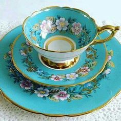 Turquoise cup and saucer set.