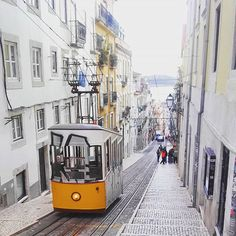 Rode this ancient tram (operating since 1885!) on the steepest hill in Lisbon today. I was the only tourist on it...and the only person under 70!!   I'm actually unsure if this is a tram or a funicular ...but either way it's beautiful!   Was a fun experience and snapped some great pics from the top. Looking forward to taking the famous Tram 28 tomorrow which goes all the way around the old town.