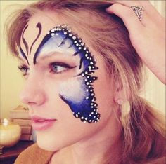 Taylor Swift dons butterfly face paint