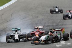 Lewis Hamilton, Mercedes AMG F1 W05 and Kimi Raikkonen, Ferrari F14-T battle for position