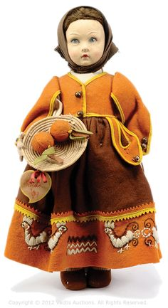 "Lenci felt Doll, label ""Lenci Torino"" to foot of skirt, felt moulded face, blue painted eyes, black mohair wig, fully jointed, dressed in felt costume with basket of felt oranges, label to orange basket ""Garda"", some fading and old moth damage otherwise Good to Good Plus, 14""/36cm."