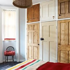 great use of old doors for built in wardrobes!