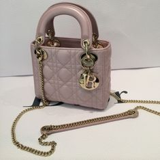 Updated as of March 2015 Introducing the Lady Dior with Chain Mini Bag. This latest Lady Dior bag is from the Cruise 2015 Collection. Dior Purses, Dior Handbags, Coach Handbags, Luxury Bags, Luxury Handbags, Lady Dior Mini, Lady Dior Bags, Dior Mini Bag, Christian Dior