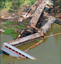 Big Bayou Canot train wreck. September 22, 1993. Mobile Alabama, USA. The derailment was caused when a towboat and barge collide with the CSX Transportation bridge in poor visibility and fog which displaced the bridge and deformed the rails. Eight minutes later, Amtrak's 'Sunset Limited' en route from L.A to Miami with 220 passengers and crew crossed the bridge and derailed at the kink. The lead locomotive embedded itself nose-first into the canal bank and exploded. The other two…