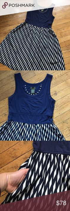 Anthropologie navy and white patterned dress This dress is the epitome of comfort and style. Top tank part is flattering, soft and well made. Feels like jersey- it's a little stretchy. Bottom silk skirt is lovely and super breathable on hot summer days. Pockets are and added plus! Can be dressed up or down for various uses! I have loved this dress so there is a little pilling on the top part Anthropologie Dresses Mini