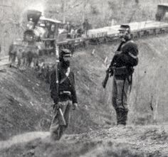 """The Center for Civil War Photography Page Liked · THIS CORPORAL STANDS GUARD ON THE HIGHER GROUND ... within this detail attributed to photographer Captain Andrew J. Russell of the United States Military Railroads. The image is from Library of Congress DIG-ppmsca-11745 which describes it as a """"Photograph showing two locomotives pulling into the Union Mills Station on the Orange and Alexandria Railroad in Clifton, Virginia."""" The Huntington Library dates this view to 1863."""