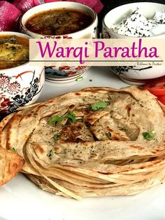 Warqi Paratha is a layered paratha , a cousin of the lachcha paratha, a Indian flatbread , from the Punjab region. This flatbread is all about its enormous layers . Indian Food Recipes, Vegetarian Recipes, Cooking Recipes, Cooking Games, Baharat Spice Recipe, Indian Dishes, Indian Breads, Punjabi Cuisine, Paratha Recipes