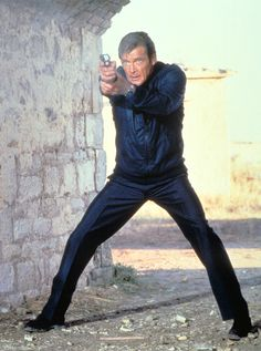 James Bond: The Chinese have a saying; Before setting out on revenge you first dig two graves. Its James Bond Night at Universal Exports! Roger Moore, James Bond Watch, James Bond Movies, Style James Bond, Movie Photo, Movie Tv, Detective, George Lazenby, Extraordinary Gentlemen