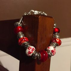 Get the look of Pandora at a fraction of the price with this European style bracelet! This design was inspired by our beloved Poland with the colors of the flag and the beautiful poppies that grace… European Style, European Fashion, Get The Look, Fashion Bracelets, Poland, Poppies, Pandora, Flag, Inspired