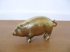Small brass pig with curly tail by Sweetpotatojack on Etsy, $18.00
