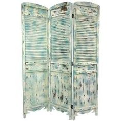 @Overstock - Shabby-chic three panel room divider in a classic Venetian screen style. Features carved apron between block feet, paneled frame, and louvered vented center. Finished in a highly distressed and antiqued white and blue with visible underlying wood.http://www.overstock.com/Worldstock-Fair-Trade/Rustic-Venetian-Cafe-5.5-foot-Room-Divider-China/6666265/product.html?CID=214117 $279.99