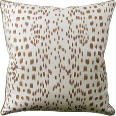 This lovely pillow features silk piping with a solid reverse. The pillow is available in two different sizes, 14