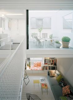 upper level courtyard / double story height living / bridge